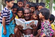 Content Adaptation. Children read a book together with their grandfather in Howrah, India. © 2015 Krishnasis Ghosh, Courtesy of Photoshare.